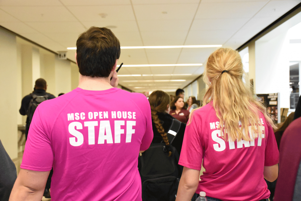 MSC Open House staff members enforcing MSC Open House rules by monitoring activity in the halls of the building.